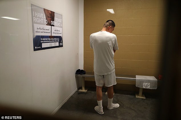 An indigenous man who fled Guatemala after surviving a gunshot wound to the head claims ICE officials at a San Diego detention center only offered him one form of medical treatment when he periodically bled from his eyes and ears with suspected brain hemorrhaging: Ibuprofen (Filed photo - pictured: A detainee stands in a cell at Otay Mesa immigration detention center in San Diego)