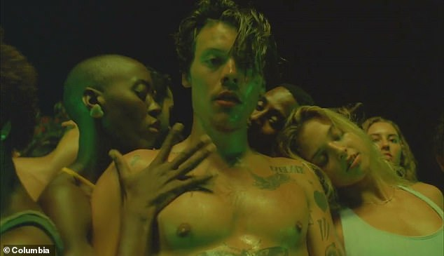 Harry Styles returned to Instagram after a year-long absence to promote his new song Lights Up on Friday... as he left fans giddy with excitement over its x-rated music video