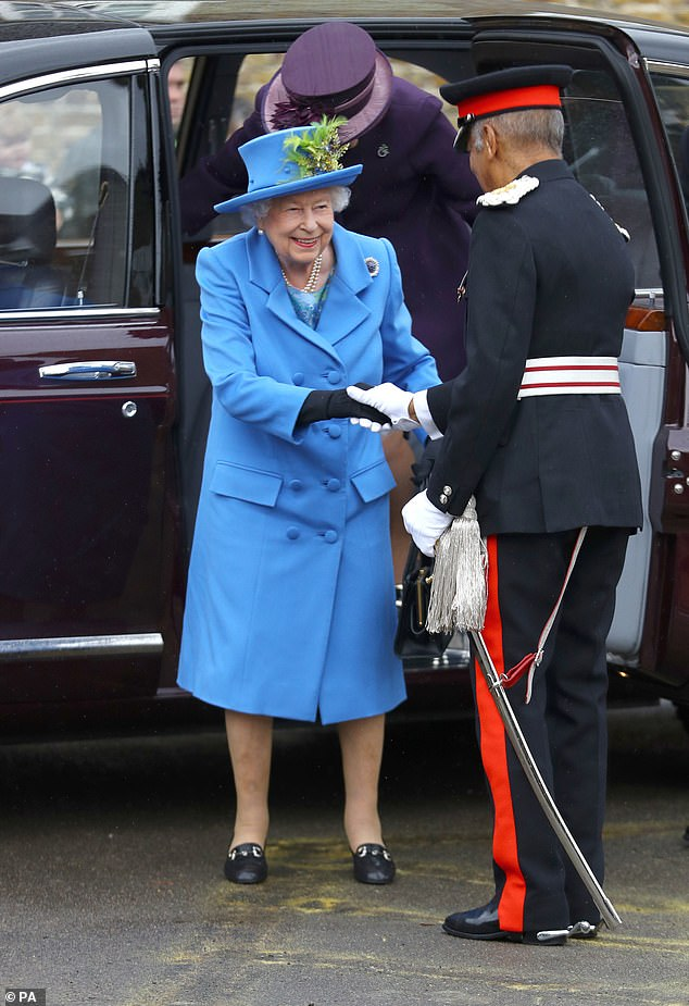 The monarch, 93, wore a baby blue double breasted coat as she arrived at the venue and greeted veterans