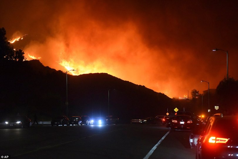 Photos capture the Saddleridge fire advancing into Granada Hills early Friday morning