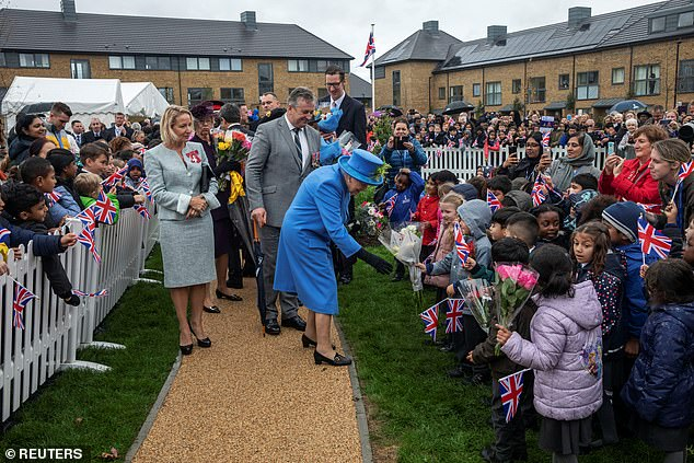 The royal was met with huge crowds of children waving Union flags during her visit today, despite the grey autumnal weather