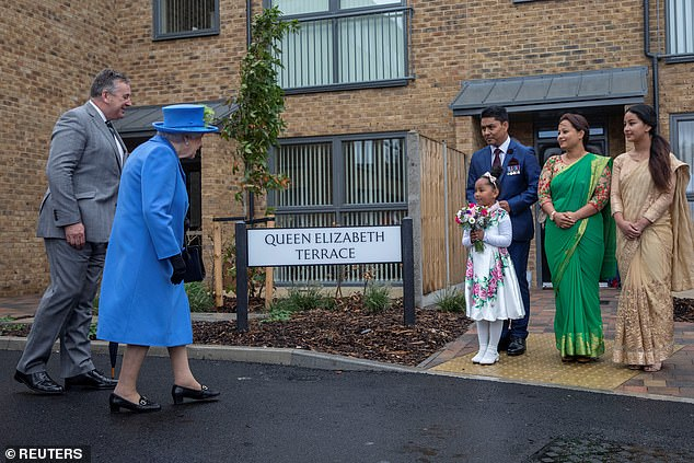 The Queen met with local families living in the housing development, which will offer homes to armed forces veterans