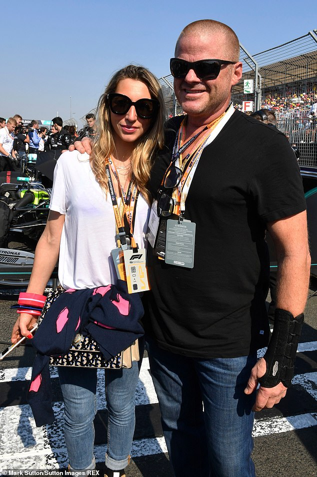 The restaurateur who is currently a judge on MasterChef Australia with his wife Stephanie at the Meblbourne Grand Prix in March 2019