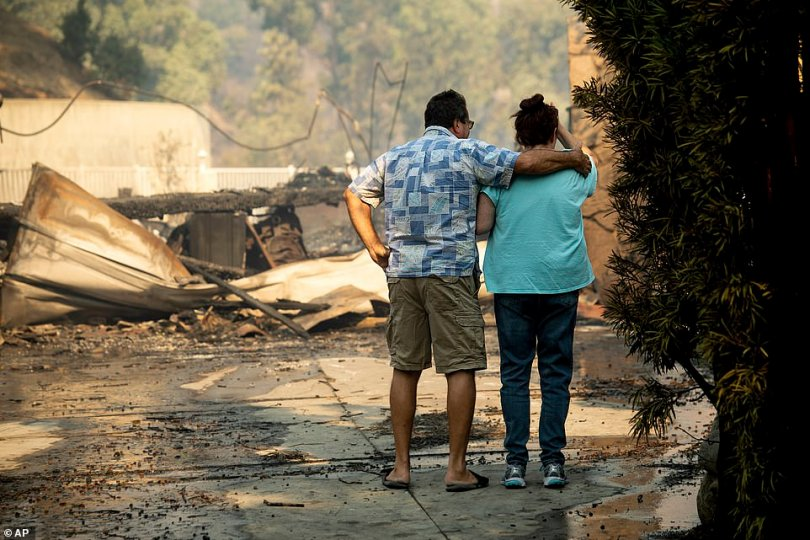 This is the heartbreaking moment families returned to find their homes and belongings destroyed by the Saddleridge Fire. Pictured:Eyed Jarjour (left) comforts a neighbor who lost her home on Jolette Avenue in Granada Hills, California, on Friday