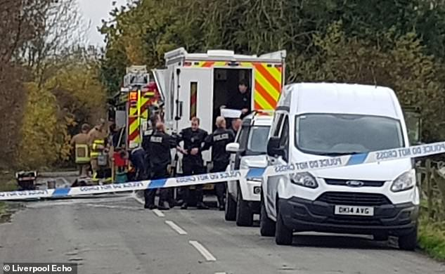 The road near the family stables is pictured cordoned off with a heavy emergency services presence after Mrs Pomphret was murdered last November