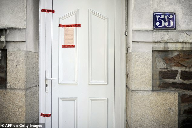 A police seal on the front door of the Dupont de Ligonnes family home in Nantes after the French authorities issued an international search alert