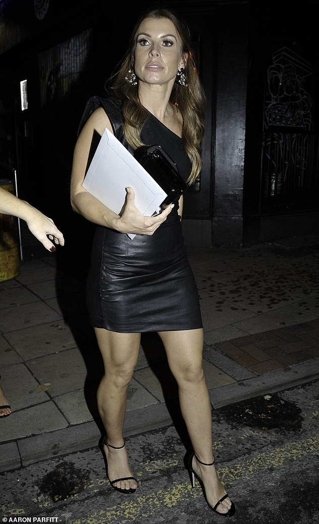 Party time!Coleen cut a seriously chic figure in a stunning leather one-shoulder mini dress, which showcased her enviably honed pins with its thigh-skimming style