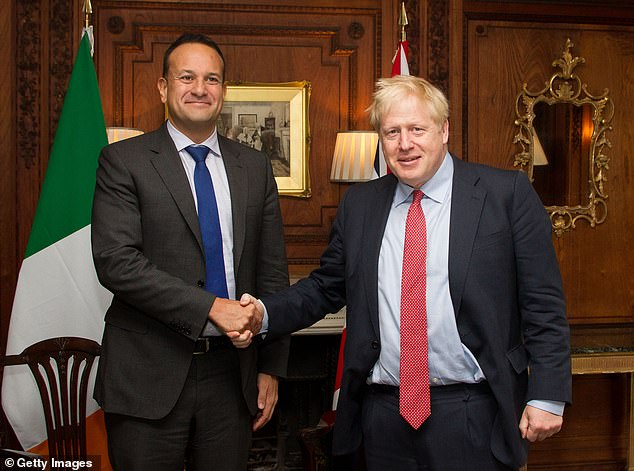 Mr Johnson met Irish premier Leo Varadkar in Merseyside on Thursday with little hope of progress. But after three hours of talks they both agreed on a 'pathway to a possible deal' (pictured together after the meeting)