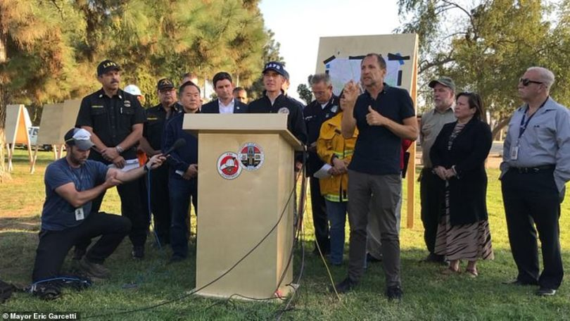 Mayor Garcetti (middle) and other officials held a press conference on Friday evening to provide residents with vital updates regarding the fires