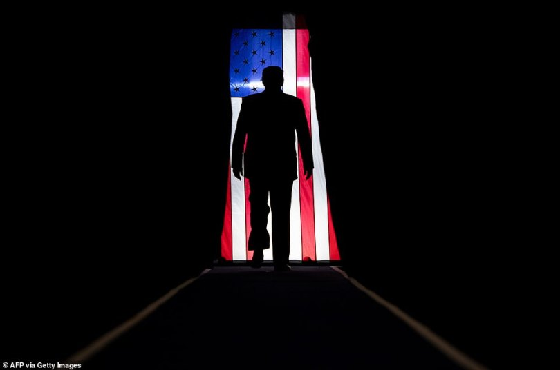 """US President Donald Trump arrives for a """"Keep America Great"""" rally at Sudduth Coliseum at the Lake Charles Civic Center in Lake Charles, Louisiana, on Friday"""