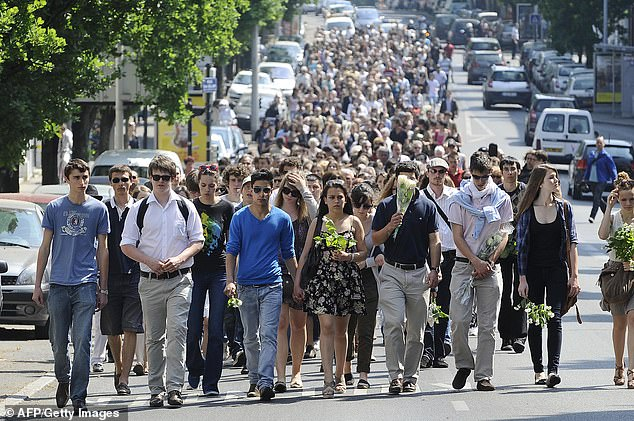 Hundreds of people take part in a march on April 26, 2011 in the French western city of Nantes, in memory of the five Dupont de Ligonnes family