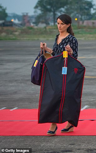 Sophie Agnew wearing a Longchamp pilot bag and suit jacket when the Cambridges arrived in 2016 for their weeklong tour of India and Bhutan
