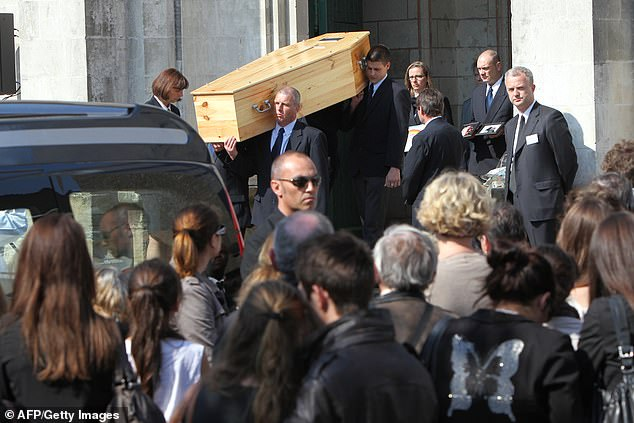 People hold the coffin of a member of the Dupont de Ligonnes family during the funeral