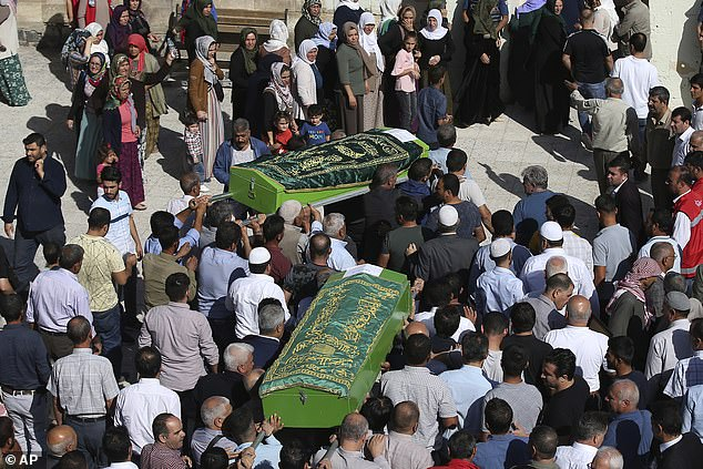 The mourners carry the coffins of Halil Yagmur, 64 years old and Muslum Guzel, killed on Friday during a mortar bombardment from Syria