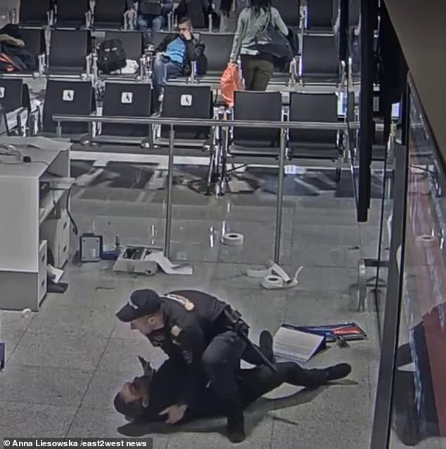 We then see the security of the airport running around the corner of Terminal B to hold the man, who was ejected dramatically to the ground.