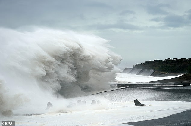 Huge waves crash against the shore in Mihana, Japan as Typhoon Hagibis gathers speed