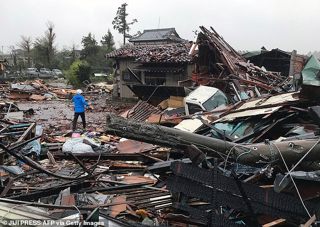 Rubble covers the ground in Ichihara, Chiba after harsh weather ripped through homes