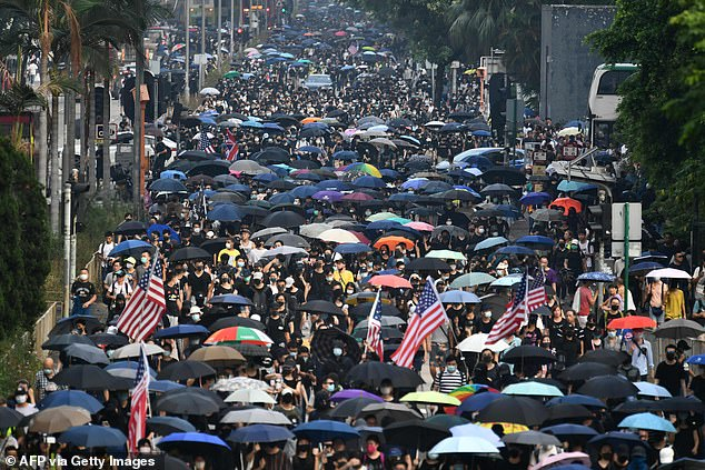 Protesters take part in an anti-emergency law march from the Tsim Sha Tsui to Sham Shui Po areas of Hong Kong
