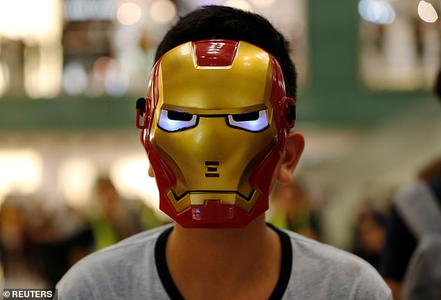 A young man wears an Iron Man face mask as he takes part in protests in Hong Kong