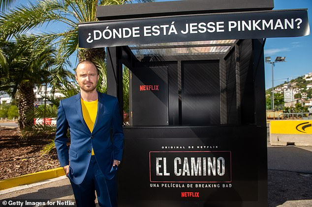 Photocall: Aaron posed in front of a booth which had the words 'Where is Jesse Pinkman' written across the front in Spanish