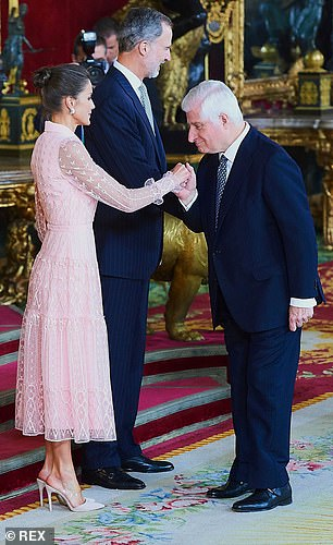 Elegant Queen Letizia smiled as a guest took her hand