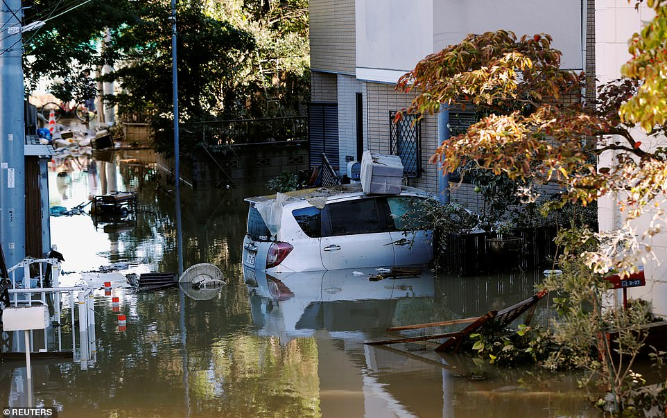 The storm claimed the first of two victims hours before arriving on the coast, when strong winds from its outer bands flipped a car in Chiba east of Tokyo and killed the driver