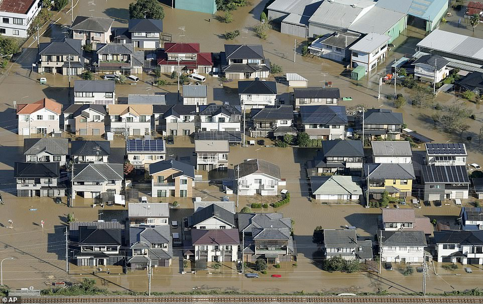 Houses are submerged after Typhoon Hagibis hit the area in Ashikaga, north of Tokyo, Japan. Some 376,000 homes were left without electricity, and 14,000 without running water