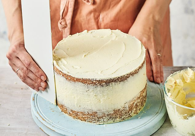 Once the whole cake is covered, use a side scraper to smooth off any excess covering on the sides. Spread and remove the buttercream until you are happy with the finish and coverage