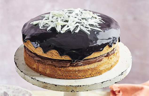Keep the liquorice icing fairly thick to stop it running all down the sides. Pour the icing over the top of the cake and decorate with white chocolate shavings to finis