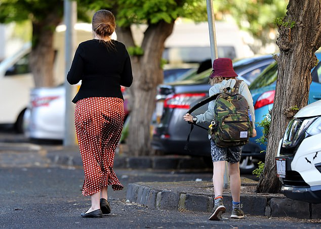 Cancer con woman Belle Gibson steps out in Collingwood to drop her son off at school. She has become one of the most despised women in Australia