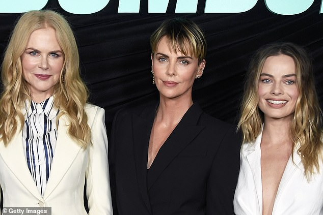 Twins: Kidman and Robbie matched in sleek white pantsuits