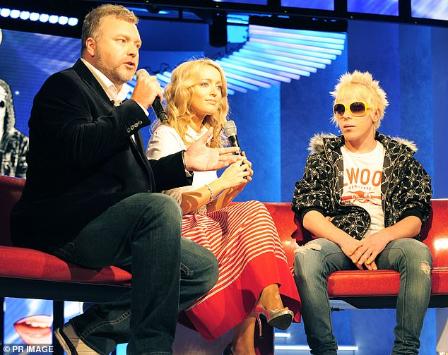 Famous:After finding fame Corey starred on Big Brother season eight later that year. Pictured: Corey with Big Brother hosts Kyle Sandilands and Jackie O in 2008