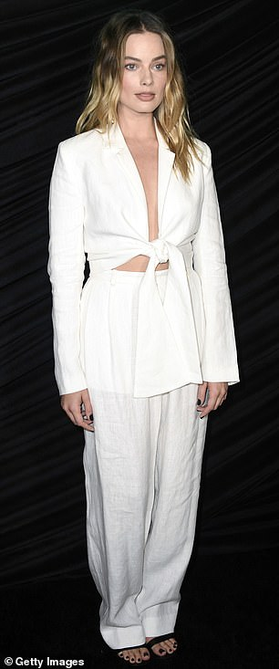 Up and coming It Girl: Margot sported open-toed footwear that displayed her dark pedicure