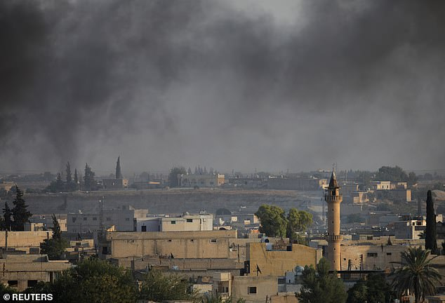 Smoke rises above the Syrian border town of Tel Abyad, as seen from Akcakale in Turkey after the NATO nation advanced further into Syria on Sunday