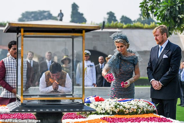 The queen threw flower petals at the historic open-air memorial which is an iconic location for many Indians across the nation