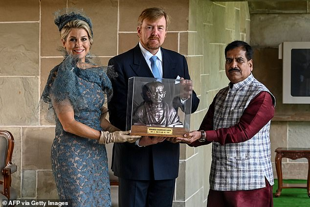 The couple later paid tribute to India's civil rights leader by posing with a statue of Mahatma Gandhi