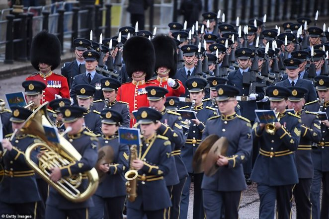 Military bands perform along The Mall ahead of the State Opening of Parliament at the Palace of Westminster today