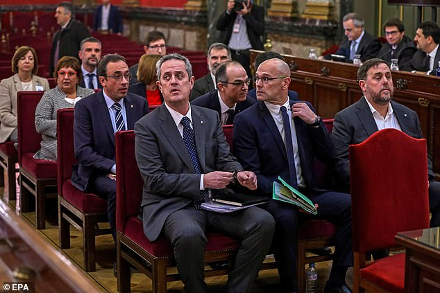 Former regional vice president Oriol Junqueras (right), former regional foreign minister Raul Romeva (centre), regional minister of interior Joaquim Forn (left) and nine other defendants at the start of the so-called 'process' trial against 12 Catalan pro-independence politicians in Madrid in February