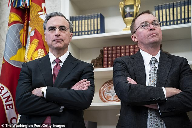 A report has White House Counsel Pat Cipollone (left) and acting Chief of Staff Mick Mulvaney (right) fighting over the impeachment defense strategy