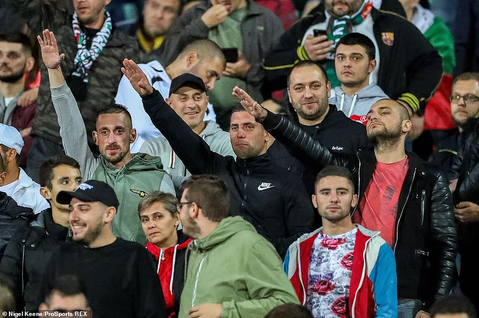 Fans do a Nazi salute despite repeated warnings about the match being stopped if that racist behaviour continued
