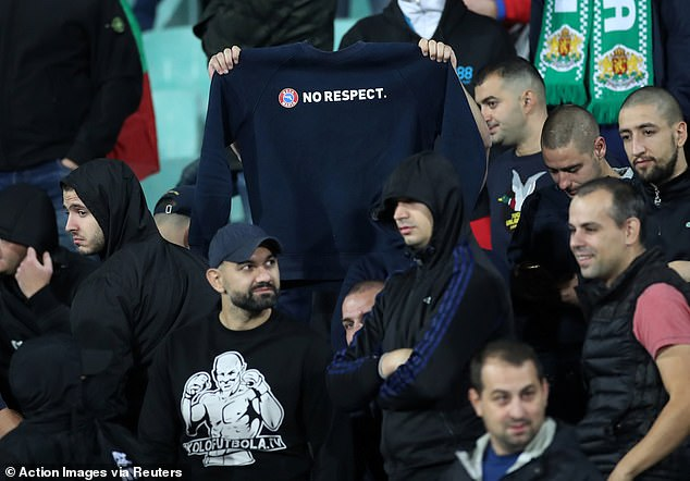 A fan holds up a No Respect jumper, a reference to UEFA's Respect campaign which encourages equality in football