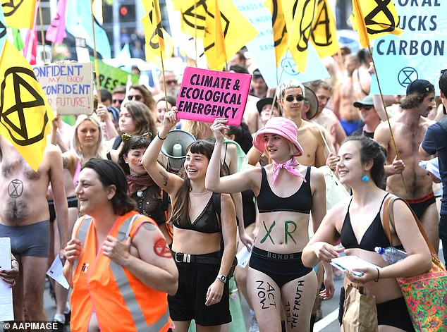 'The hourglass symbolises the threat of extinction and that time is running out,' the group wrote online (pictured at the Melbourne Nudie March)