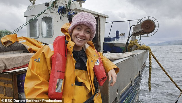 Co-presenter Cherry Healey on a crab fishing boat in BBC2's What Britain Buys and Sells