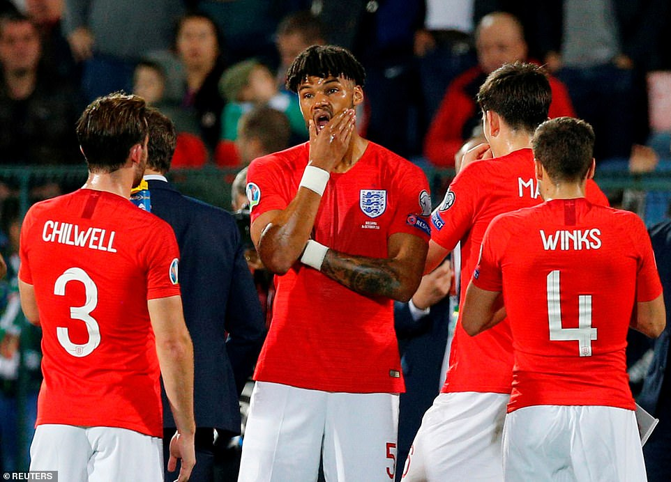 Tyrone Mings (centre) making his debut for England, was the first player to report the abuse which led to the first stoppage