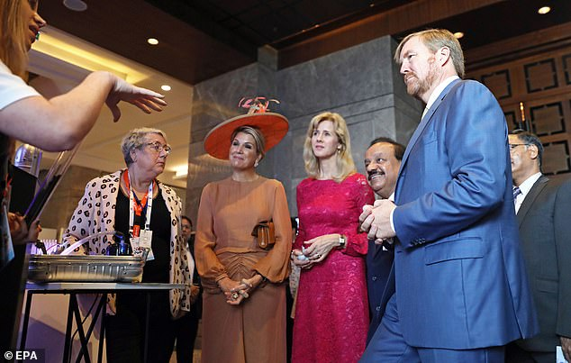 Joining his wife for the event was husband King Willem-Alexander (right) who donned a slick blue suit