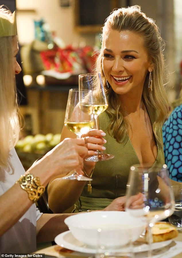 Cheers! The former Bachelor star shared a toast with her mother as they enjoyed a traditional Christmas dinner, prepared by Curtis