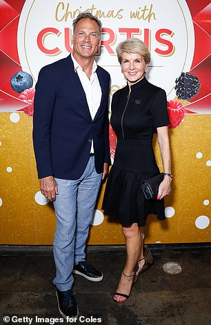 Picture-perfect: Julie wore a black frock with zipper detail and strappy heels, while David donned a white shirt, light blue jeans, a suit jacket and sneakers