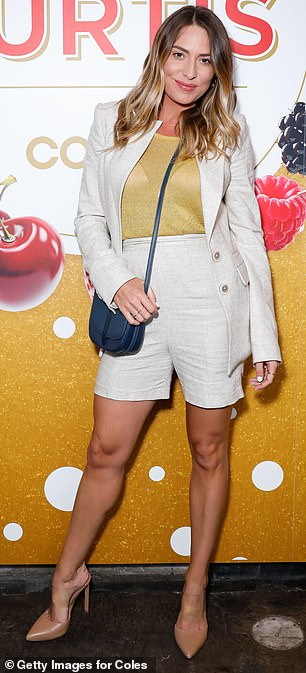 Leggy lady: Lisa Clark, 34, donned a mustard top tucked into high-waisted beige shorts that showed off her trim pins
