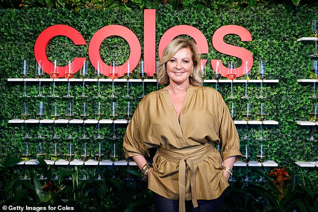 One for the mantelpiece: Chyka looked sensational as she posed in front of Coles signage