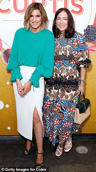 Style: Kylie is pictured with Nova radio host Michael 'Wippa' Wipfli's wife Lisa, who wore an abstract frock with puffy sleeves and white strappy heels